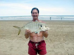 Roger with his Golden Travelly caught from a Hawaii beach U.S.A