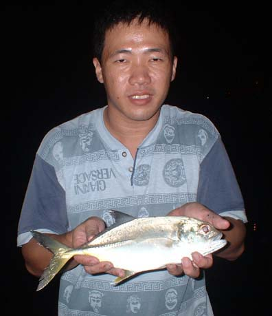 Ron with his Big Eye Travelly caught at night by surfcasting. Rare Catch